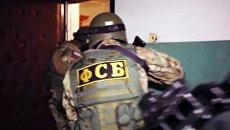 Задержание Меджида Магомедова, подозреваемого в планировании убийства одного из лидеров ДНР, сотрудниками ФСБ РФ в Смоленской области. 10 сентября 2018