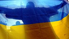 Болельщики сборной Украины смотрят матч Саудовская Аравия-Украина в Ганновере, Германия. 19 июня 2006