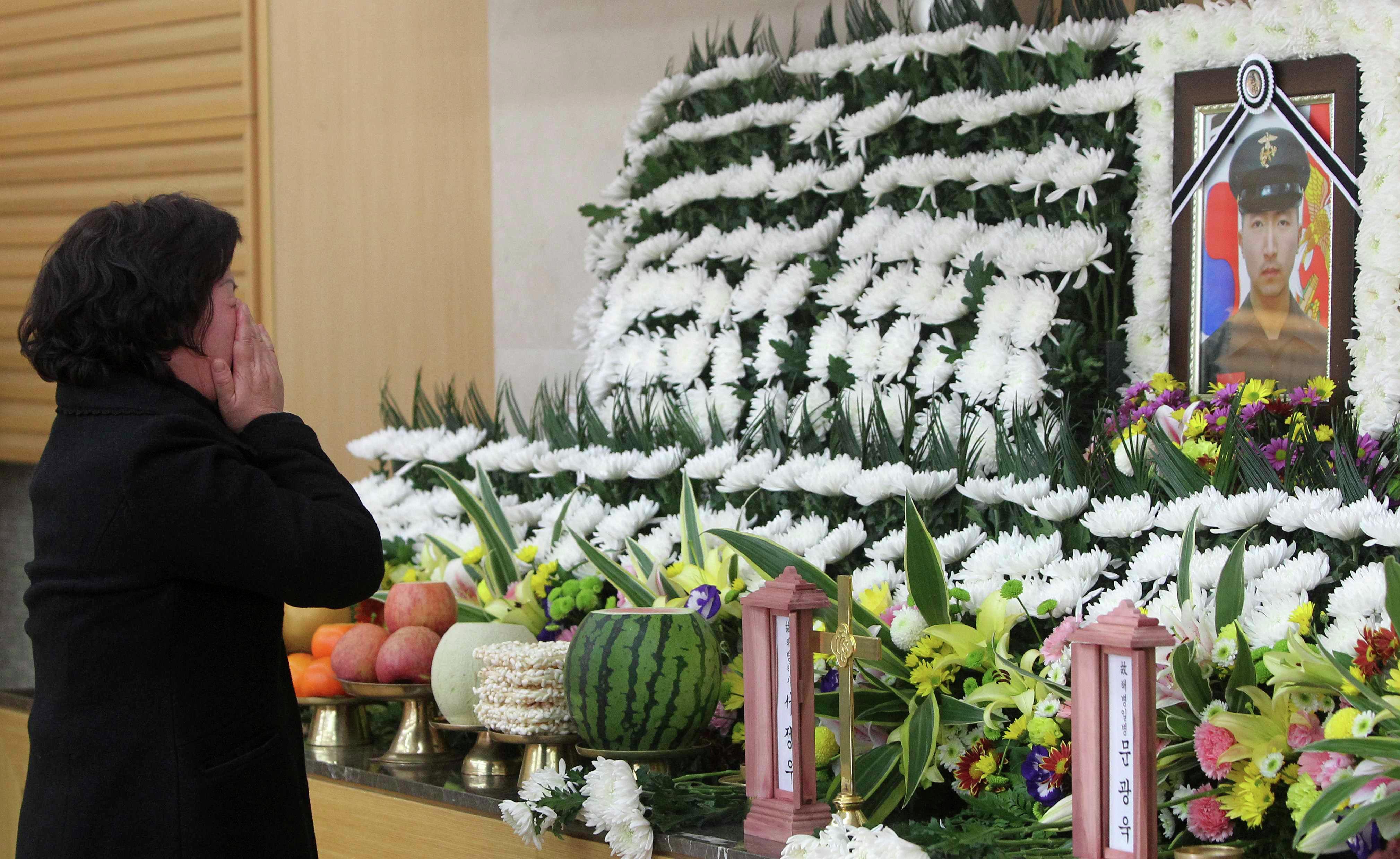 Родственники погибших в результате военного конфликта Северной и Южной Кореи