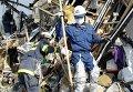 Поисково-спасательные работы в городе Сендай в Японии