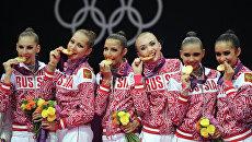Российские гимнастки завоевавшие золотые медали в групповых соревнованиях по художественной гимнастике