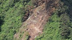 Нераскрытый спасательный трап на месте катастрофы российского самолета Sukhoi SuperJet-100