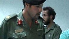 Кадры, на которых объявленный убитым сын Каддафи навещает раненых