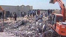 От больницы на северо-западе Ливии остались руины после авиаудара НАТО