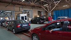 Работа пункта государственного технического осмотра автомобилей. Архив