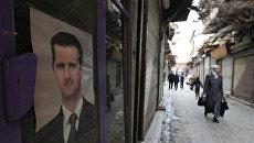 Прохожие на улицах сирийской столицы. Архив