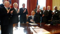 Барак Обама подписал закон о предоставлении России статуса нормальных торговых отношений и списке Магнитского