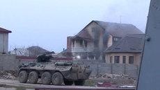 Стрельба и дым из окон: кадры штурма здания с боевиками в Дагестане