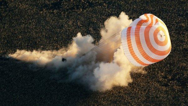 Спуск с МКС капсулы с Олимпийским факелом. Фото с места события