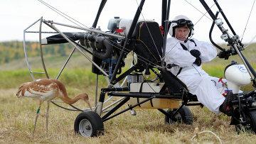 Владимир Путин принял участие в экологическом проекте Полет надежды
