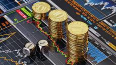 Монеты, биржевые графики. Архивное фото