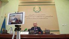 Председатель Национального Банка Республики Казахстан Кайрат Келимбетов на пресс-конференции, посвященной девальвации тенге. 11 февраля 2014